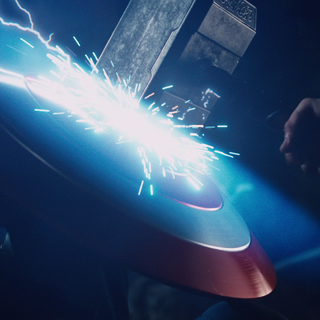 Cap's shield blocking Thor's hammer.