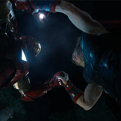 Thor and Iron Man battle.