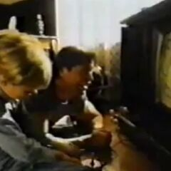 Young Johnny playing videogames with <a href=