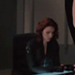 Natasha at the Avengers meeting.