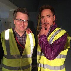 Robert Downey Jr. posing with producer Jeremy Latcham on set