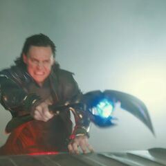 Loki fires his staff at pursuing S.H.I.E.L.D. Agents and Nick Fury.