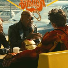 Natasha with Nick Fury and Tony Stark.