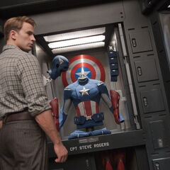 Steve looks at his uniform on display.