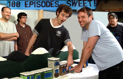 File:SpMatt and Trey Cutting 100th Episode Cake.jpg