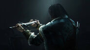 Talion looks to the broken sword of his son2