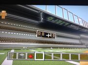 Red fires stadium scoreboard and seats