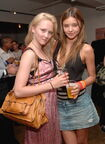114558549-amy-finllayson-and-miranda-kerr-during-le-gettyimages
