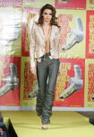 182315228-model-wearing-yellow-fever-fall-2005-during-gettyimages