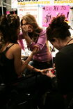 52151992-model-gets-her-makeup-applied-backstage-at-gettyimages
