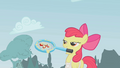 Apple Bloom smiling with tennis racket S1E12.png