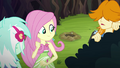 Fluttershy looks over at a gopher hole EG4.png