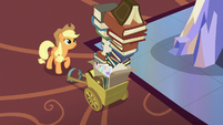 Applejack looking at tall stack of photo albums S6E21