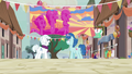 Party Favor hanging the Sunset Festival banner again S6E26.png