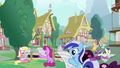 Background ponies reading S2E23.png