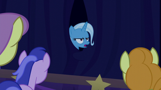 File:Trixie appears annoyed from behind the curtain S6E6.png