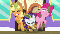 AJ, Rarity, and Pinkie struggling to exit the door S6E22
