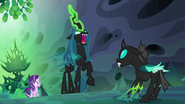 Queen Chrysalis raising her horn to Thorax S6E26