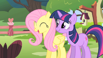 Fluttershy and Twilight look at Opal clawing Rarity S1E17