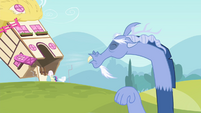 Discord sneezing onto a house S4E11