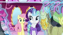 Rarity looking through a clothing rack S5E21