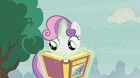 Sweetie Belle opening the book of fairy tales S7E8