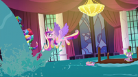 Princess Cadance flying out of the summit hall S5E10