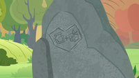 Rock carved with Mac and Butter's cutie marks S7E13