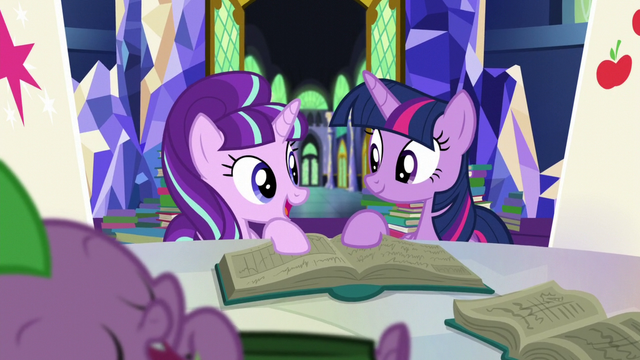File:Starlight and Twilight look at each other while holding book S5E26.png