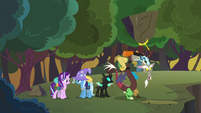 Discord looks for Fluttershy under a large rock S6E25