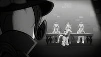 Rarity looks at Rainbow and the castle guards S5E15