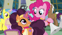 Pinkie Pie and Saffron smiling at each other S6E12