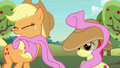 Applejack pulls off Apple Bloom's oversized bow S7E9.png