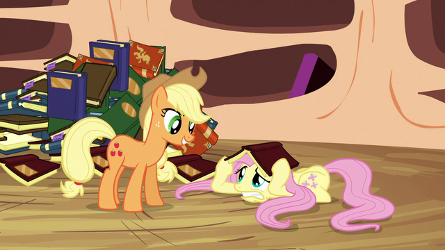 File:Fluttershy covers her head with a book S3E05.png