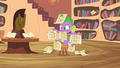 Spike holding up letters S2E13.png