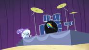 Trixie hiding behind drum platform EG2