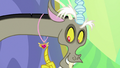 Discord looking at his medal S7E1.png