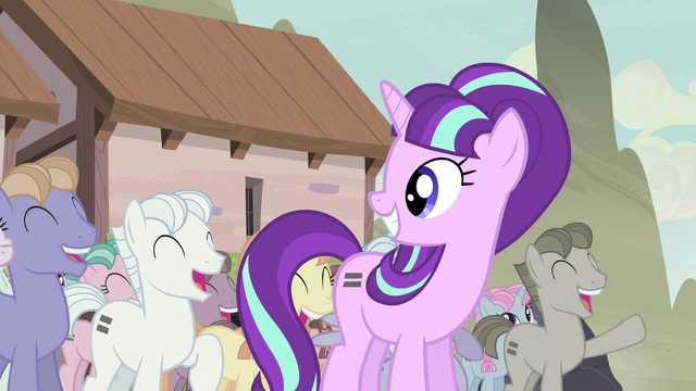 File:Starlight smiling at the cheering equalized ponies S5E02.png