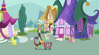 Discord pushing a shopping cart through town S7E12