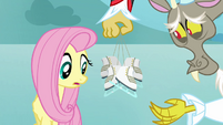 Discord tempts Fluttershy with ice skates S03E10