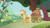 Applejack pulling a cart filled with apples S1E10