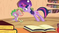 Twilight showing Spike the calendar S2E20