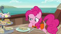 Pinkie inspecting a cucumber sandwich S6E22