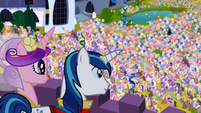 Shining Armor and Cadance looking down to the crowd S2E26