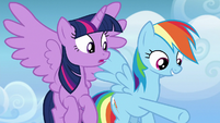 Rainbow Dash pointing toward Spitfire and trainees S6E24