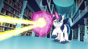 Shining Armor conjures a shield to deflect the magic beam S6E2