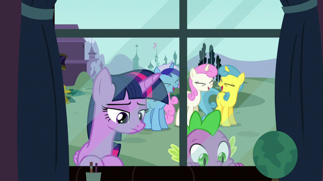 File:Twilight looks back at her past while her old friends are laughing S5E12.png