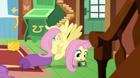 Fluttershy picking up a bit purse S6E17