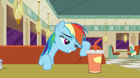 Rainbow Dash leaning against her seat S6E9