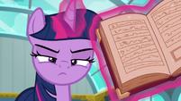 Twilight Sparkle levitating a textbook S6E24